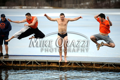 1/19/2013 Mike Orazzi | Staff Jeff Glowa, Robert Palko and Shane Altwies take the plunge during the Annual Camp Sloper Polar Bear Plunge on Saturday in Southington.