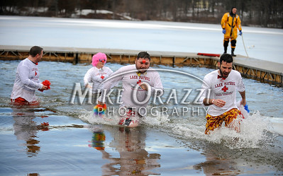 1/19/2013 Mike Orazzi | Staff Members of the Lake Compounce team General Manager Jerry Brick, Michael Cordani, Barbara Parlee and Chris Perry take the plunge during the Annual Camp Sloper Polar Bear Plunge on Saturday in Southington.