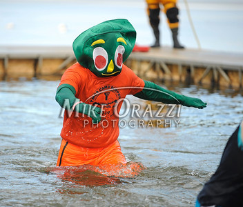 1/19/2013 Mike Orazzi | Staff Brian Patenaude, dressed as Gumby,takes the plunge during the Annual Camp Sloper Polar Bear Plunge on Saturday in Southington.