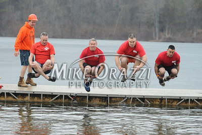 1/18/2014 Mike Orazzi | Staff Members of the Southington fire department during the Ninth Annual Southington YMCA Polar Plunge on Saturday at Camp Sloper in Southington.