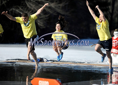 1/16/2010 Mike Orazzi | Staff Southington High School teachers, left to right: Evan Tuttle, Mary Tess Driver and Heather Allenback  while taking a dip in frigid water at the 5th Annual YMCA Polar Plunge at Camp Sloper in Southington on Saturday.