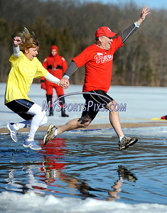 1/16/2010 Mike Orazzi | Staff Southington YMCA executive director John Myers and his wife Moira take the plunge during the 5th Annual YMCA Polar Plunge at Camp Sloper in Southington on Saturday.