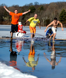 1/16/2010 Mike Orazzi | Staff Southington YMCA Outdoor Center Director Mark Pooler, Lou Angelillo and Pat Rosin take the polar plunge during the 5th Annual YMCA Polar Plunge at Camp Sloper in Southington on Saturday.