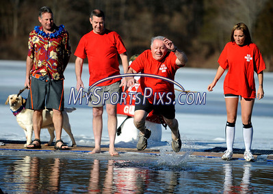 1/16/2010 Mike Orazzi | Staff Southington firefighters Nelson DeAngelo takes a leap into frigid water at the 5th Annual YMCA Polar Plunge at Camp Sloper in Southington on Saturday.