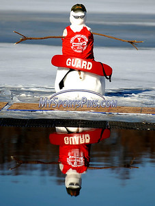 1/16/2010 Mike Orazzi | Staff A snowman lifeguard during the polar plunge at Camp Sloper in Southington on Saturday.