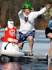 1/16/2010 Mike Orazzi | Staff Al Natelli takes the polar plunge at Camp Sloper in Southington on Saturday during the 5th Annual YMCA Polar Plunge. Watching from the water is Southington firefighter Bill Cummings.