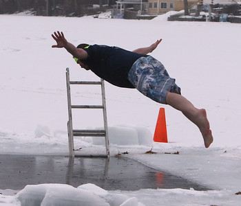 Polar plunge to benefit Special Olympics, at the Shoreline Beach Club in Tyngsboro. Joel Dolan does a belly flop. No diving was allowed. (SUN/Julia Malakie)