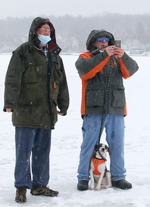 Polar plunge to benefit Special Olympics, at the Shoreline Beach Club in Tyngsboro. Mark Rowbotham of Tyngsboro, left, and Gary Normandin of Dracut, with his dog Henry, watch the plungers. (SUN/Julia Malakie)