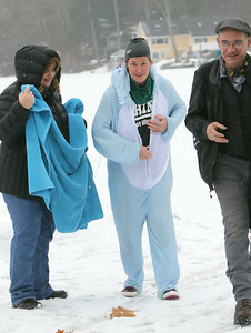 Polar plunge to benefit Special Olympics, at the Shoreline Beach Club in Tyngsboro. Joy Manning of Tyngsboro, center, with husband Angelo Senzapaura, right, and her sister Sharon Semenza of Troy, N.H., left.(SUN/Julia Malakie)