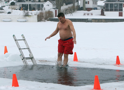 Polar plunge to benefit Special Olympics, at the Shoreline Beach Club in Tyngsboro. Rick Airosus of Nashua jumps in feet first. (SUN/Julia Malakie)
