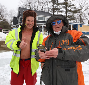 Polar plunge to benefit Special Olympics, at the Shoreline Beach Club in Tyngsboro. Rick Airosus of Nashua, left, with Gary Normandin of Dracut, who'd shot a video of his plunge. (SUN/Julia Malakie)