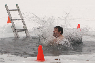 Kevin Casey of Tyngsboro does the polar plunge to benefit Special Olympics, at the Shoreline Beach Club in Tyngsboro. (SUN/Julia Malakie)