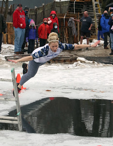 Beth Craig of Tyngsboro, one of the organizers, does the polar plunge to benefit Special Olympics, at the Shoreline Beach Club in Tyngsboro. (SUN/Julia Malakie)