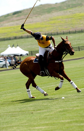 "JKW rider Mircelo Fraure swings his mallet to pass the ball during a polo match at Ashlawn Farms north of Boulder, Saturday, June 19, 2010. <br /> <br /> For a video of the game, please visit  <a href=""http://www.dailycamera.com"">http://www.dailycamera.com</a><br /> Kasia Broussalian"