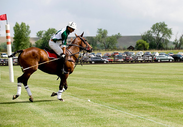 "Hospice Care Leadership rider Santiago Mendez, from California, (front left) swings his mallet to put the ball back in play during a polo match at Ashlawn Farms north of Boulder, Saturday, June 19, 2010. <br /> <br /> For a video of the game, please visit  <a href=""http://www.dailycamera.com"">http://www.dailycamera.com</a><br /> Kasia Broussalian"