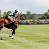 """Hospice Care Leadership rider Santiago Mendez, from California, (front left) swings his mallet to put the ball back in play during a polo match at Ashlawn Farms north of Boulder, Saturday, June 19, 2010. <br /> <br /> For a video of the game, please visit  <a href=""""http://www.dailycamera.com"""">http://www.dailycamera.com</a><br /> Kasia Broussalian"""