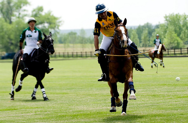 "JKW rider Tanweer Khan, of Colorado Springs, scores a goal during a polo match against Hospice Care Leadership team at Ashlawn Farms north of Boulder, Saturday, June 19, 2010. <br /> <br /> For a video of the game, please visit  <a href=""http://www.dailycamera.com"">http://www.dailycamera.com</a><br /> Kasia Broussalian"
