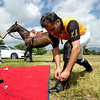 """Tanweer Khan, of Colorado Springs,  stretches and laces his boots before the start of a polo match at Ashlawn Farms north of Boulder, Saturday, June 19, 2010. <br /> <br /> For a video of the game, please visit  <a href=""""http://www.dailycamera.com"""">http://www.dailycamera.com</a><br /> Kasia Broussalian"""