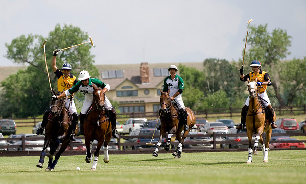 """Hospice Care Leadership rider Santiago Mendez, from California, (front left) swings his mallet to connect with the ball during a polo match at Ashlawn Farms north of Boulder, Saturday, June 19, 2010. <br /> <br /> For a video of the game, please visit  <a href=""""http://www.dailycamera.com"""">http://www.dailycamera.com</a><br /> Kasia Broussalian"""