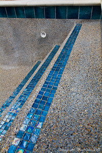 The decorative glass tile we chose for the steps and bump out (after acid wash)