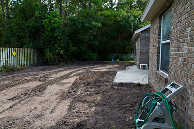 Back trees & sod removed, patio cut, land graded