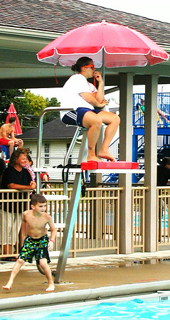 Debbie Blank | The Herald-Tribune<br /> Lifeguard Becca Wintz, 22, was one of many supervising the action.