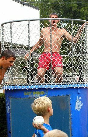 Debbie Blank | The Herald-Tribune<br /> Lincoln Garrett (foreground), 7, Batesville, gets ready to successfully dunk lifeguard Michael Hoeing.