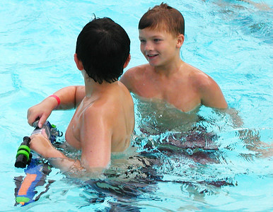 Debbie Blank | The Herald-Tribune The pool party was a time to relax with friends after a few days of school.