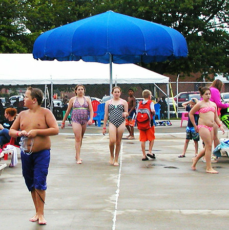 "Debbie Blank | The Herald-Tribune<br /> About 500 adults and children attended the Back to School Bash at the pool. ""We were thrilled,"" reports pool manager Elizabeth Hall. ""The staff had fun doing it."" At 9 p.m. families watched ""The Croods"" under the big blue umbrella. Next summer there will be two parties, at the beginning and end of the season."