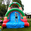 Debbie Blank | The Herald-Tribune<br /> Ryan Duerstock, 7, Oldenburg, finishes making his way through a giant inflatable with a slide ride.