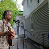 5/14/16 FITCHBURG-- Following a city wide clean up on Saturday, event organizers put together Porchfest- an event where local musicians perform outside their homes in Fitchburg.  Roland Gibson playing his guitar for a small crowd outside a home in Fitchburg. Sentinel & Enterprise photo/Jeff Porter