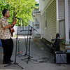 5/14/16 FITCHBURG-- Following a city wide clean up on Saturday, Newvue Communities put together Porchfest- an event where local musicians perform outside their homes in Fitchburg.  Here is Roland Gibson playing guitar for a small crowd outside a home in Fitchburg. Sentinel & Enterprise photo/Jeff Porter