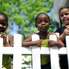 5/14/16 FITCHBURG-- Following a city wide clean up on Saturday, Newvue Communities put together Porchfest- an event where local musicians perform outside their homes in Fitchburg. Three girl's Michoki Kabaya, 5, Kwamboka Kabaya, 3, and Jarieliz Gonzalez, 7, hanging out around porchfest on Saturday.  Sentinel & Enterprise photo/Jeff Porter