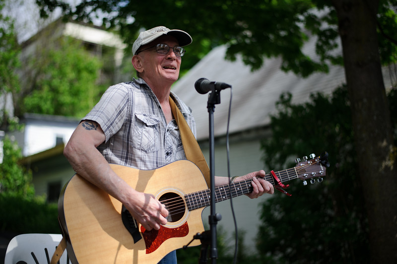 5/14/16 FITCHBURG-- Following a city wide clean up on Saturday, Newvue Communities put together Porchfest- an event where local musicians perform outside their homes in Fitchburg.  Here Walter Oppenheimer performs at the end of a High St. driveway.  Sentinel & Enterprise photo/Jeff Porter