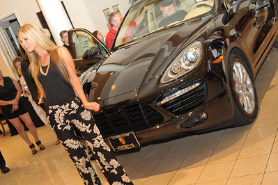 Gaudin Porsche in Las Vegas unveiled the new 2011 Porsche Cayenne last night in a fireworks of good times thanks to sponsors Gaudin, Porsche Design, Eccoci Fashions, Cars & Coffee, The Weiland Group, The Tailored Man, Bretts & Scholl, Dark & Stormy Goslings Rum and Terrisa & Company Models. Photographs by Mark Bowers, Las Vegas photographer.