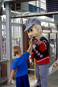 Coquitlam Express mascot greets a young rider. Vintage CPR train rides, Port Coquitlam 2013 Homecoming celebration