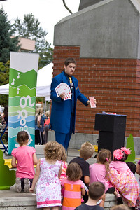 Local magician Alex Seaman performs to children at Leigh Square. Port Coquitlam Homecoming weekend, August 17, 2013. Free concerts at Leigh Square and PoCo Rec Complex.