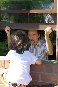 Local kid discussing the Leader's new look with Chris, at the newspapers secret walk up complaint and or growl like a tiger window.