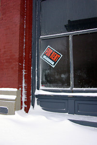 Sign of the times part two Snow and empty storefronts. 18Jan12