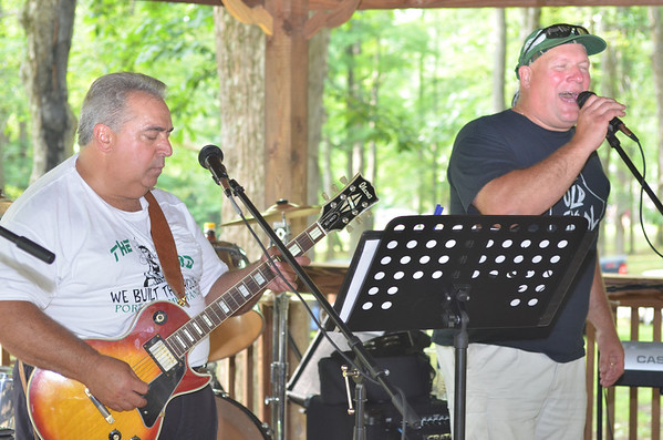 """Portage Area Superintendent Rich Bernazzoli (left) rocks out with vocalist Mark Kudkawiec as their band """"Old Skool"""" played the 2013 Portage Area Summerfest Saturday in Crichton McCormick Park."""