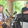 "Portage Area Superintendent Rich Bernazzoli (left) rocks out with vocalist Mark Kudkawiec as their band ""Old Skool"" played the 2013 Portage Area Summerfest Saturday in Crichton McCormick Park."