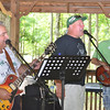 """Portage Area Superintendent Rich Bernazzoli (left) rocks out with vocalist Mark Kudkawiec and bassist Brett Tozer as their band """"Old Skool"""" played the 2013 Portage Area Summerfest Saturday in Crichton McCormick Park."""
