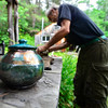 KRISTOPHER RADDER - BRATTLEBORO REFORMER<br /> Potter Richard Foye cleans off the soot from a pot that he finished on Tuesday, July 11, 2017.