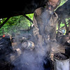 KRISTOPHER RADDER - BRATTLEBORO REFORMER<br /> Potter Richard Foye uses wood shavings to create a smokey look on a pot on Tuesday, July 11, 2017.