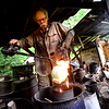 KRISTOPHER RADDER - BRATTLEBORO REFORMER<br /> Potter Richard Foye uses castor oil on a pot that was fired to 1600 degrees on Tuesday, July 11, 2017.