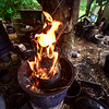KRISTOPHER RADDER - BRATTLEBORO REFORMER<br /> Potter Richard Foye uses pine needles to help put out a copper look on a pot on Tuesday, July 11, 2017.