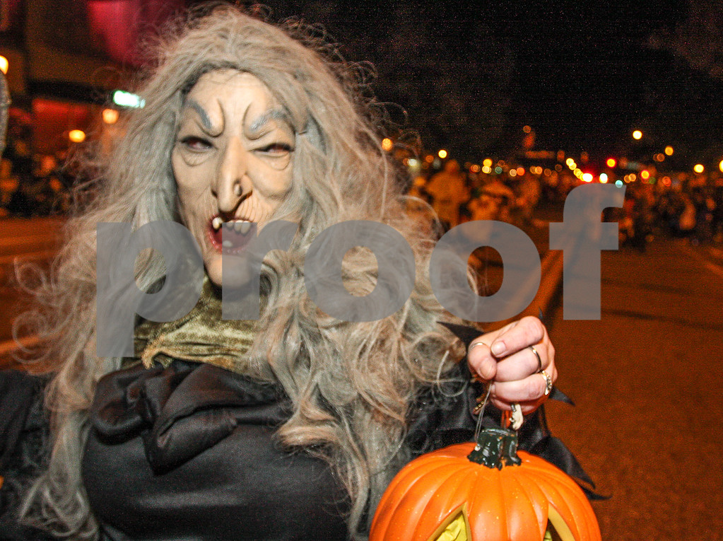 . This ghoulish figure shows off her pumpkin. Photo by Kevin Hoffman, the Mercury
