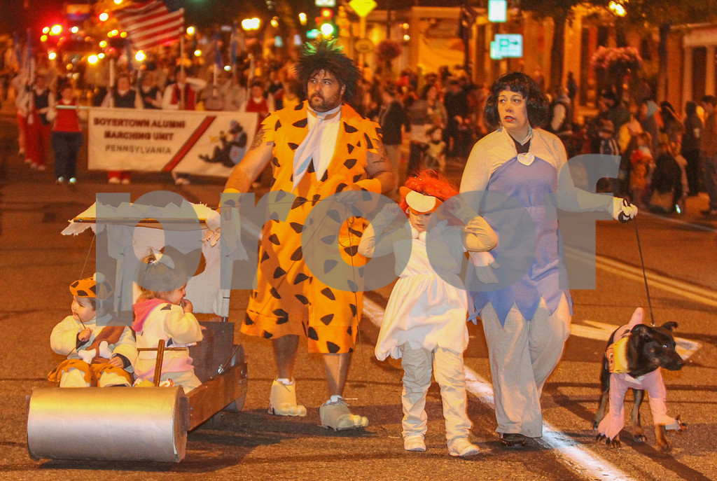. The Flintstones walked the parade route down High St. Photo by Kevin Hoffman, the Mercury