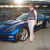 Prager Huron NACUBO : After having taken a speedy lap around the oval at the Indianapolis Motor Speedway, event guests and clients posed for photographs with a new Chevrolet Corvette Izod Pace Car.