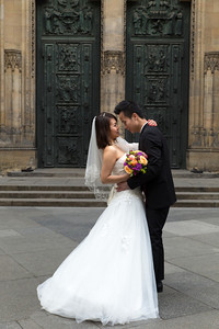 A couple having their wedding formals in front of the cathedral
